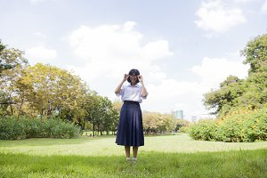 Schoolgirl standing on the lawn.