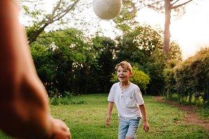 Cute little boy playing football