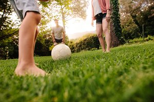 Family playing football in garden la