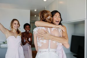 Bridesmaid congratulating the bride