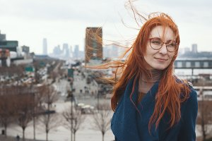 Young woman with red hair in front of New York skyline