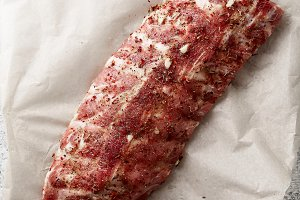 Raw pork ribs rubbed with spicy marinade