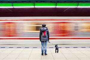 Woman with dog at subway station