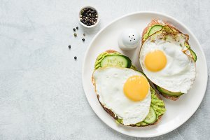 Egg, avocado and cucumber toasts