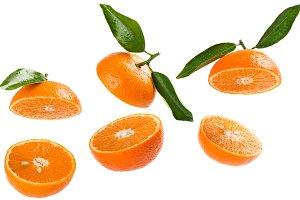 Halves of tangerines in air.