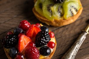 Fruit tarts on a wooden table