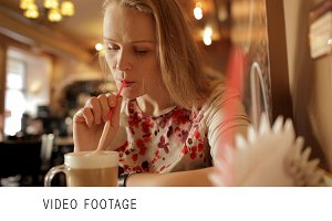 Girl is drinking coffee latte cafe
