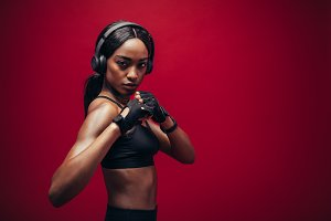 Female boxer with fighting stance