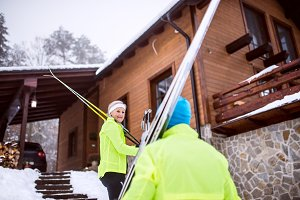 Senior couple going cross-country skiing.