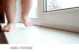 Baby legs. First steps. Slow motion.
