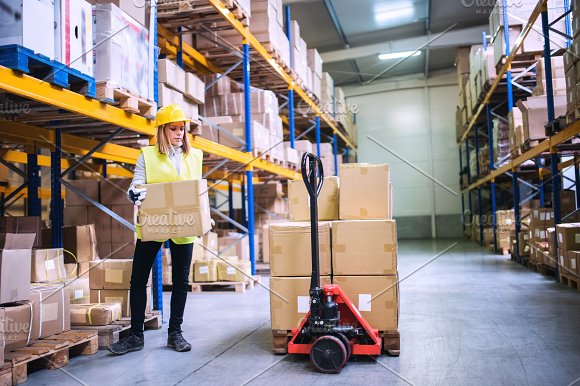 Female Warehouse Worker Loading Boxes