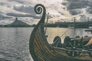 Stylized Viking boat on the river in Riga