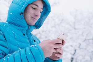 teenager with smartphone and blue ja