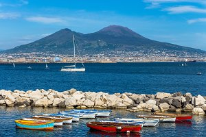 Wooden boats, Vesuvius on background