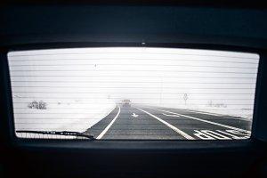 Vision window car rear snowy landsca