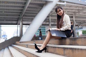Happy businesswoman sitting