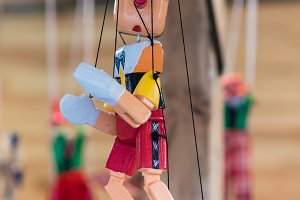 Pinocchio hung from the threads