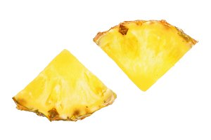 two slices of pineapple isolated on white background close-up. Top view. Flat lay