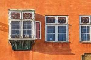 Bay window on bright facade.