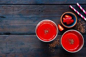 Red smoothie in jars