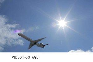 Aircraft in the sky. Sun rays.