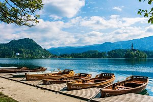 Few polished row boats on Lake Bled.