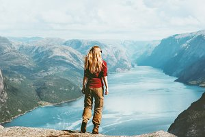 Woman traveler sightseeing Lysefjord