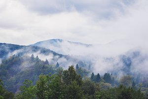 Mountains covered by clouds and fog.