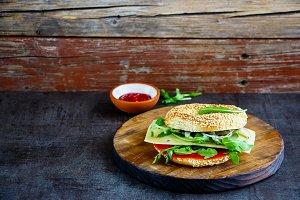Tasty sandwich on bagel