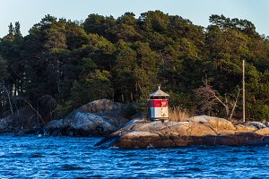 Striped red-white low lighthouse.
