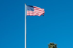 USA stars and stripes flag against blue sky