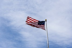 American Flag on the blue sky.