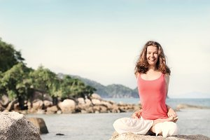 Young woman yoga teacher smiling dur
