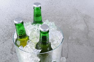 Three Beer Bottles in Ice Bucket