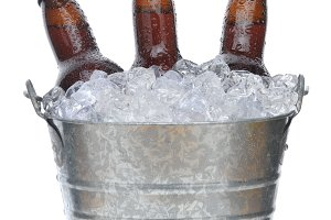 Three Brown Beer Bottles in Ice Buck