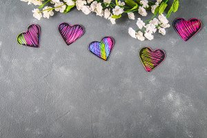 Homemade Black violet pink hearts on a gray concrete background. The concept of Valentine's Day. A symbol of love.