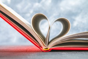 The pages of the book in the red cover are made in the form of a heart. The concept of Valentine's Day.