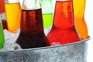 Closeup of Soda Bottles in Bucket