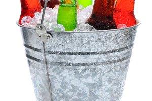 Assorted Soda Bottles in Ice Bucket