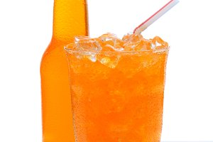 Glass of Orange Soda with Bottle