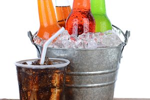 Cold Soda Bottles in a Bucket Full o