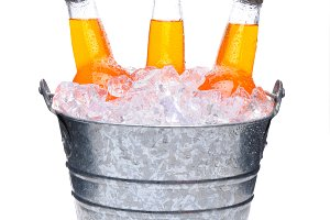 Orange Soda Bottles in Bucket