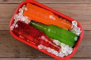 Sodas on Ice in Red Cooler