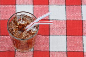 Glass of Soda with Straws on Table C