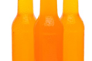Three Orange Soda Bottles on White