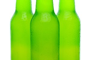 Three Lemon Lime Soda Bottles on Whi