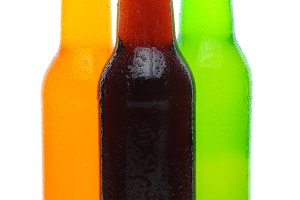 Three Assorted Soda Bottles on White