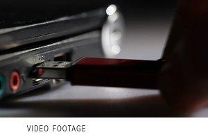 Inserting red usb flash drive