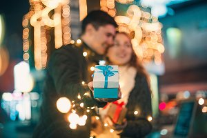 romantic surprise for Christmas, woman receives a gift from her boyfriend