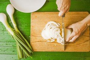 Girl cutting fresh onions